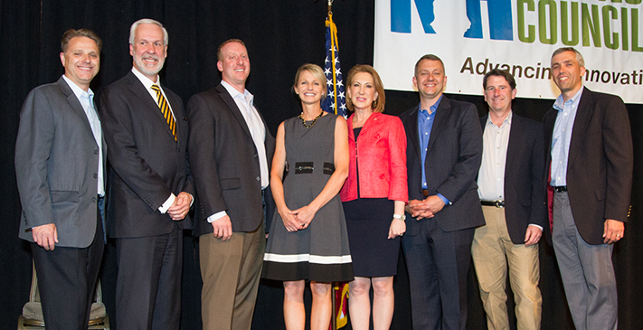 EOY Award winners from Single Digits and Southern New Hampshire celebrate with keynote speaker Carly Fiorina. Pictured L to R: Paul Mailhot of Dyn; Paul LeBlanc of SNHU; Steve Singlar and Jody Holt of Single Digits; Carly Fiorina; and Robert Goldstein of Single Digits.