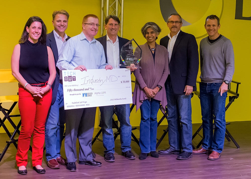 TechOut first place winner Jim Kelly holds a check for his $50,000 prize at the NH High Tech Council's and Alpha Loft's competition on October 7. Also pictured from left to right are: Michelline Dufort of the NH High Tech Council and Cookson Strategies, Paul Mailhot of Dyn and the NH High Tech Council, Matt Cookson of the NH High Tech Council and Cookson Strategies, Toral Cowieson of the NH High Tech Council and the Internet Society, Mark Kaplan of Alpha Loft, and Matt Rightmire of Borealis Ventures.